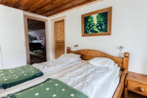 Sovrum med dubbelsäng lägenhet Utsikten.